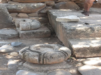 Close up of the circular stone bases for the wooden columns around the throne in the city gate of Dan.