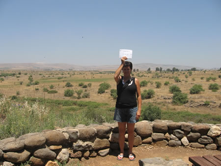 Toni holds the label showing the border of Lebanon to the left and the border of Syria to the right from a location near Jeroboam's shrine in Dan.